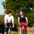 Stock Photo: Young fitness couple doing