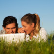 Young couple lying together on — Foto Stock
