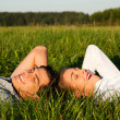 Young couple lying together on — Stock Photo #5052376