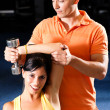 Young woman lifting a dumbbell — Stock Photo