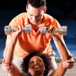 Young woman lifting a dumbbell — Stock Photo #5052504