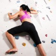 Woman exercising at a climbing — Stock Photo #5052612