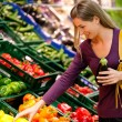 Woman in a supermarket at the — Stock Photo #5052807