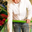 Man in the supermarket — Stock Photo