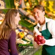 Woman in a supermarket at the — Stock Photo