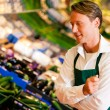 Shop assistant in a — Stock Photo