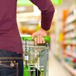 Woman in the supermarket - Stock Photo
