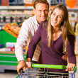 Couple in a supermarket - Stock Photo