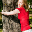 Stock Photo: Girl cuddling tree and