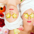 Two girls relaxing in a wellness - Stock Photo