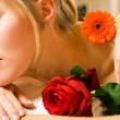 Woman enjoying a massage in a — Stock Photo #5056928