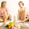 Girls having a casual chat while — Stock Photo