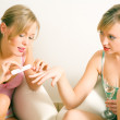 Girls having a casual chat while — Stock Photo #5056970