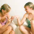Girls having a casual chat while — Stock Photo #5056972
