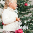 Young girl helping decorating — Stock Photo