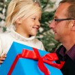 Young girl receiving a gift from — Stock Photo