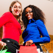 Two women in a shopping mall — Stock Photo #5057264