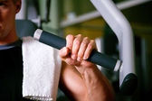 Man working out in the Gym on — Stock Photo