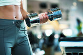Woman lifting hand weights — Stock Photo
