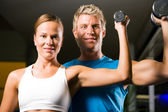 Couple (male and female) lifting — Foto Stock
