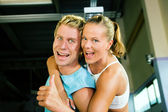 Couple in a gym having a lot of — Stock Photo