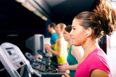 Running on treadmill in gym — Stok fotoğraf