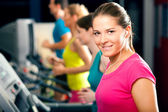 Running on treadmill in gym — Foto Stock