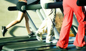 Three on the treadmill — Stock Photo
