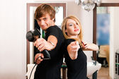 Two hairdresser - man and — Stock Photo