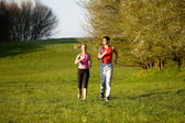 Athletic young couple jogging — Stock Photo