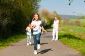 Kids running down a path in — Stock Photo
