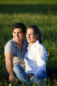 Young couple sitting together — Stock Photo