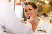 Male customer in supermarket — Stock Photo