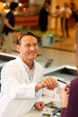 Male customer in supermarket — Stock Photo