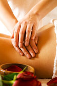 Woman enjoying a massage in a — Stock Photo