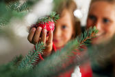 Young girl helping decorating — Foto Stock