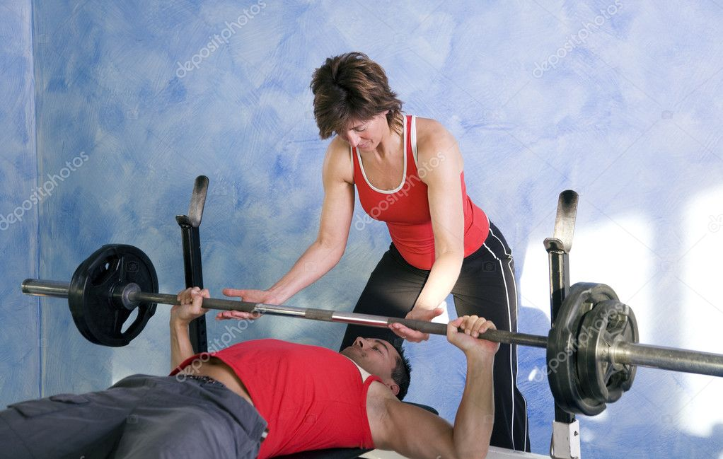 Assisted by a personal trainer  — Stock Photo #5051246