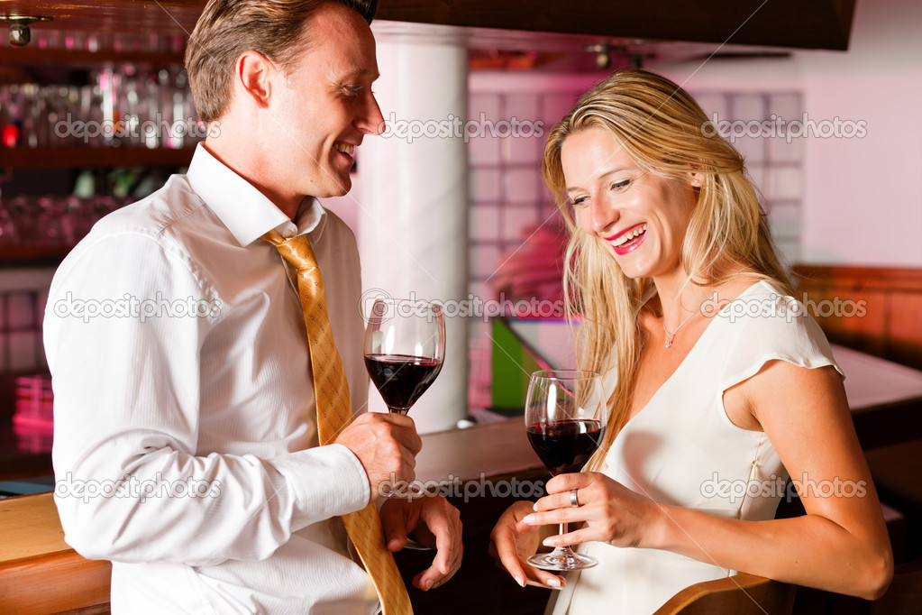 In the evening having glasses of red wine and a little flirt  — Stock Photo #5051892