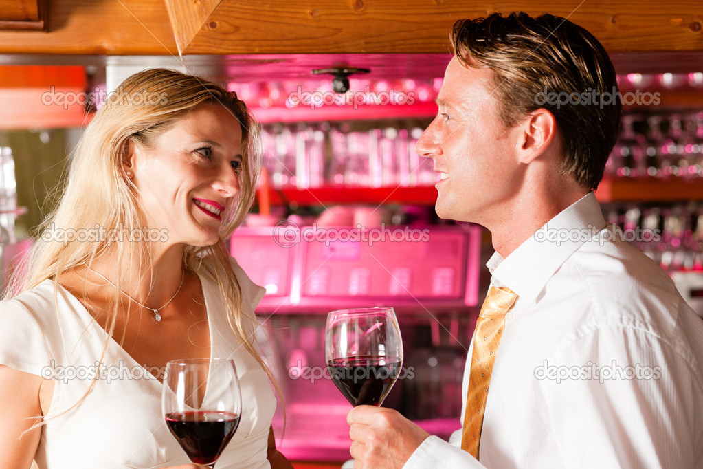 In the evening having glasses of red wine and a little flirt   Stock Photo #5051894