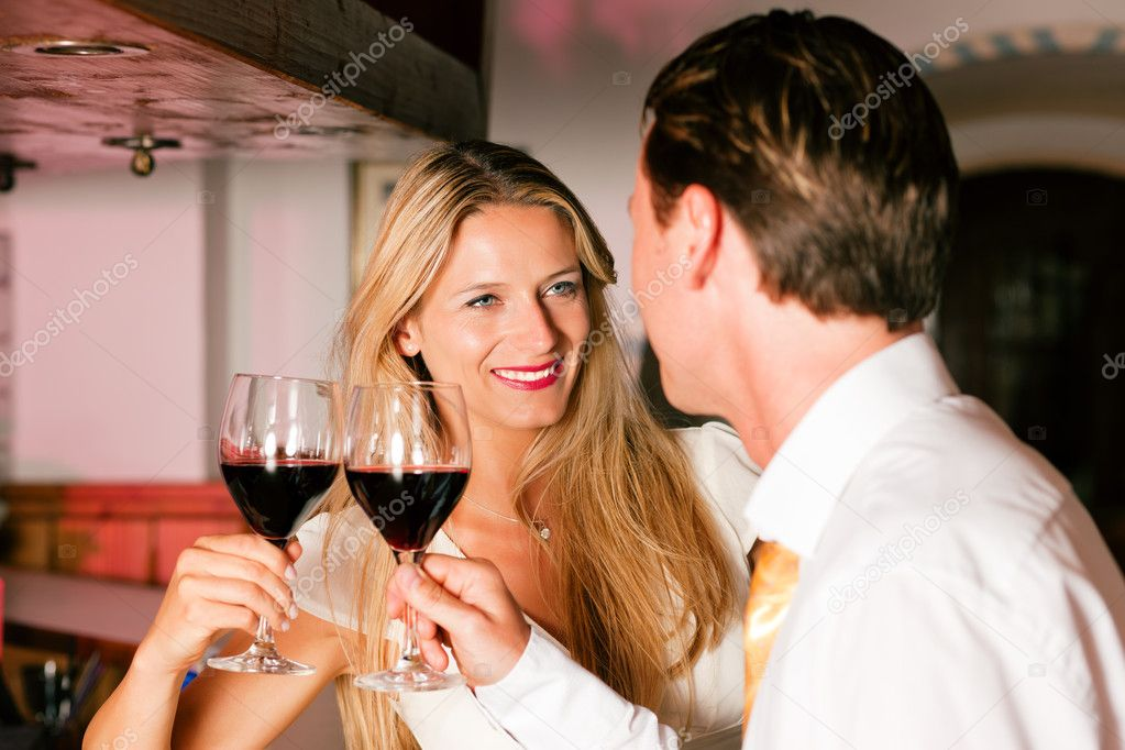 In the evening having glasses of red wine and a little flirt  — Stockfoto #5051897