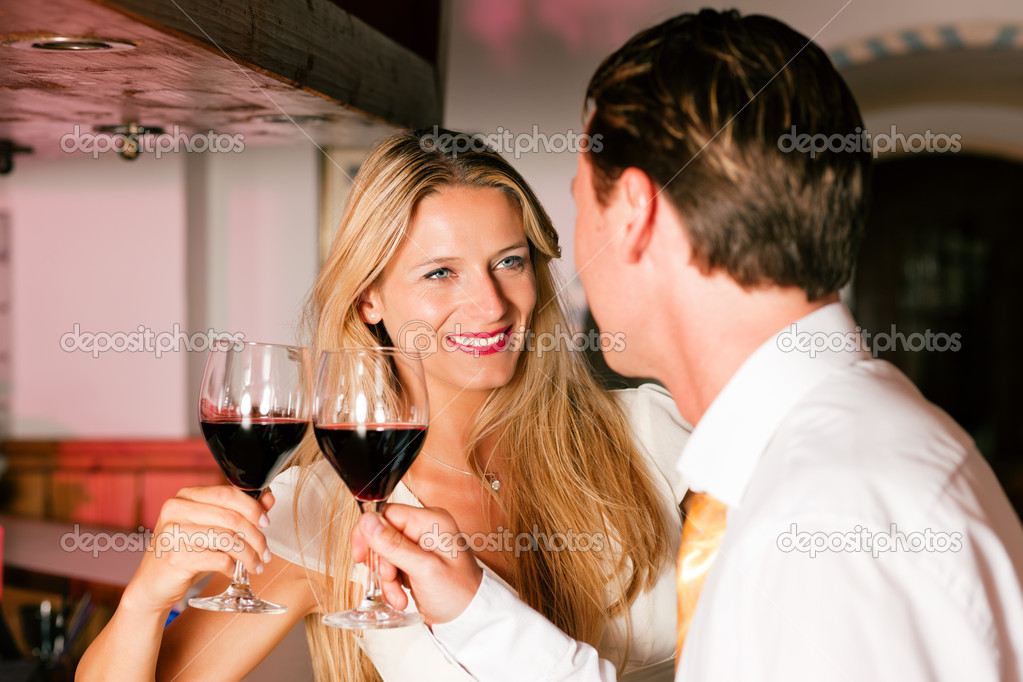 In the evening having glasses of red wine and a little flirt  — Stock fotografie #5051897