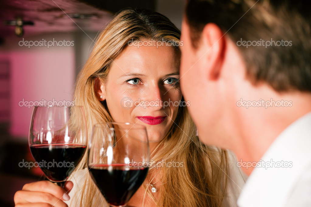 In the evening having glasses of red wine and a little flirt  — Foto de Stock   #5051898