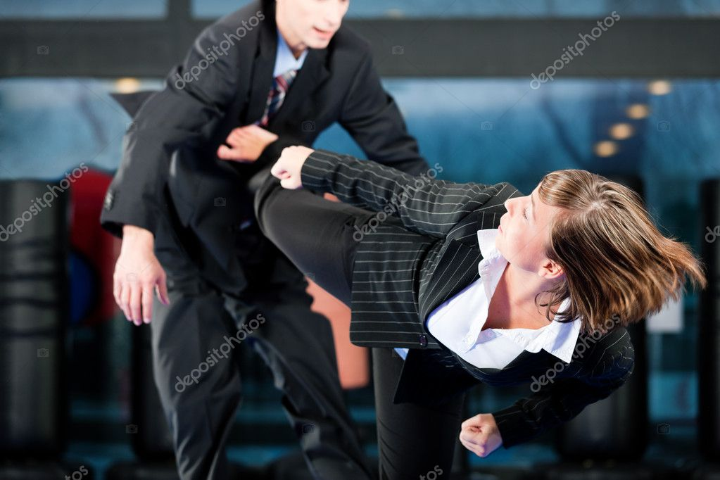 Gym in martial arts training exercising Taekwondo, both wearing suits — Stock Photo #5052127