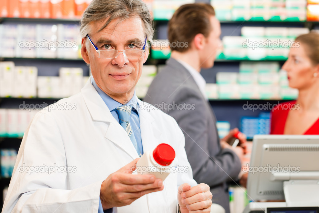 Pharmacy, he is holding a bottle with pharmaceuticals in his hand  — Stock Photo #5052249