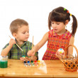 Little children painting the easter eggs — Stock Photo
