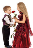 Little boy gives a girl a rose — Stock Photo