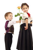 Little boy gives a girl a yellow rose — Stock Photo