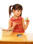 Little child painting the easter eggs — Stock Photo