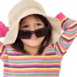 Smiling little girl in straw and sunglasses — Stock Photo