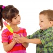 Stock Photo: Little children sharing the color ice cream